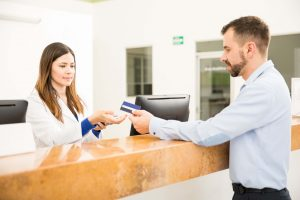 person paying for medical treatment